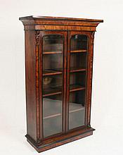 A Victorian walnut and ebony floor standing bookcase