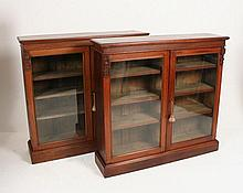 A pair of William IV walnut dwarf bookcases