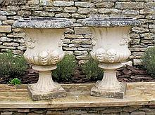 A pair of 'Sandford Stone' reconstituted stone classical garden urns