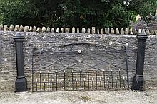 An Imposing Cast Iron Black Painted And Parcel Gilt Garden Gate