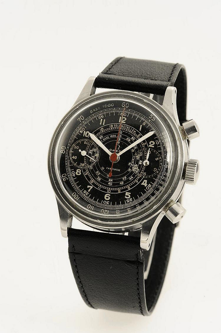 (*) Omega, Swiss, Movement No. 9384865, Case No. 9555491, Cal. 33.3 CHRO T2, 38 mm, circa 1944