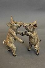 A cold painted bronze figure of two pigs kissing,