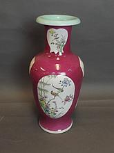 A Chinese cerise ground pottery vase with painted