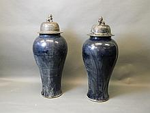 A pair of blue glazed large Chinese temple vases