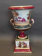 An early C20th porcelain urn in the Vienna style