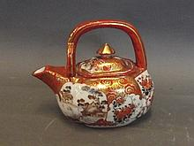 A Japanese Kutani teapot decorated with birds and