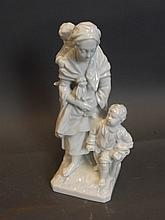 A C19th white glazed Berlin figure group of a