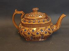 A C19th copper lustre teapot with raised