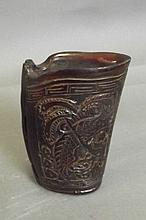 A Chinese horn cup with carved dragon and phoenix