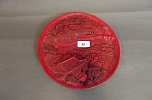 A Chinese cinnabar lacquer style dish decorated