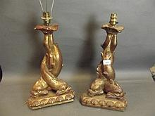 A pair of early C20th gilt composition table lamps