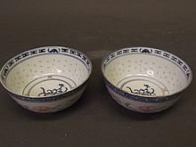 A pair of Chinese blue and white rice bowls,