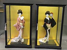 Two large Geisha dolls, in display cabinets, 13½