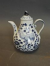 A Chinese blue and white teapot decorated with a