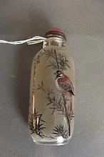 A Chinese reverse painted snuff bottle with fine