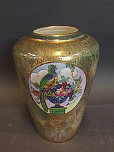 A Minton lustre vase printed with an exotic bird