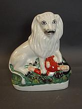A later Staffordshire figure of a lion standing