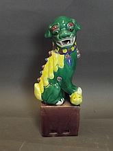 A Chinese pottery Fo dog with a green and yellow
