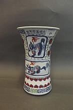 An early C20th Chinese Gu shaped pottery vase