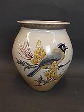 A large ceramic vase decorated with a bluetit