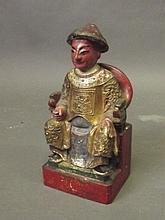 An Oriental carved wood and gilt figure of a