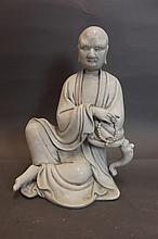 A Chinese blanc-de-chine figure of a seated sage,