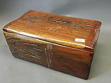 A box constructed of Rhodesian red teak wood