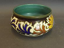 A Gouda shallow bowl with Dahlia floral pattern