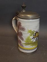 A C19th Scandinavian tin glazed pottery tankard