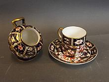 A Royal Crown Derby coffee can and saucer, and a