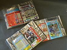 Three folders containing football programs of