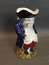 A C19th Staffordshire Toby jug in the form of a