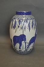 An Art Pottery vase decorated with elephants, 12