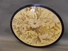 A C19th oval framed embroidery, 21½