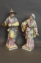 A pair of Meissen style figures of Chinese