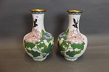 A pair of white ground cloisonné vases decorated