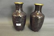 A pair of purple ground cloisonné vases decorated