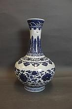 A Chinese blue and white vase with stylised lotus