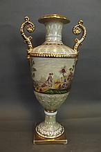 A Continental pottery twin handled vase painted