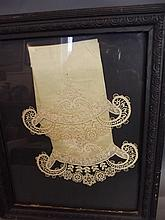 A framed lace and silk sample, 13¾