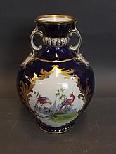 An ovoid twin handled crescent vase painted with