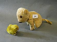 A wind model toy chick and a stuffed seated puppy
