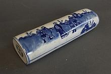 A Chinese blue and white cylindrical wrist rest