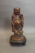 A Chinese soapstone figure of Lohan with a toad,