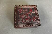 A Chinese yellow stone seal in a red hardstone box