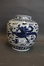 A Chinese blue and white jar with dragon