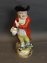 A Staffordshire William Kent Toby jug depicting a