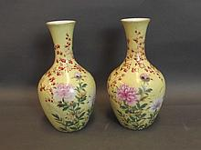 A pair of yellow ground Japanese vases painted