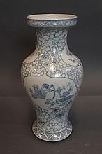 A Chinese blue and white vase with painted floral