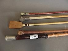 Five various riding crops including silver topped